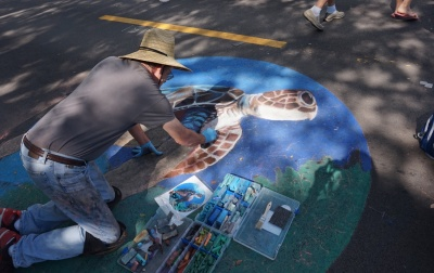 Naples artist drawing on the blacktop